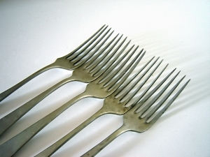 Maybe if I jabbed you in the neck with a fork, you'd remember to put them in the right way!